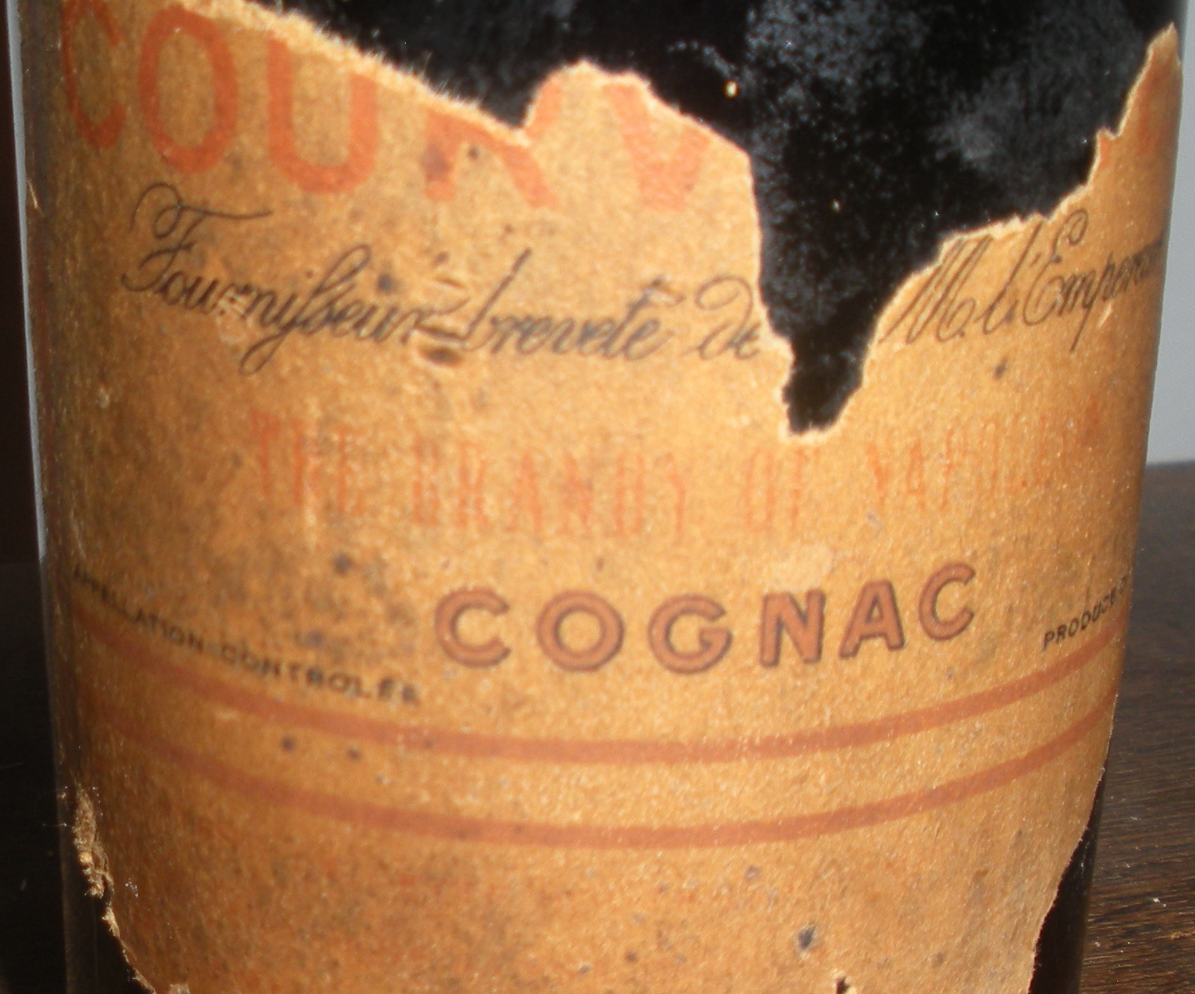 "Spectactular! A ""The Brandy of Napoleon"" Fournisseur Breveté de S.M. l'Empereur Courvoisier Cognac Bottle"