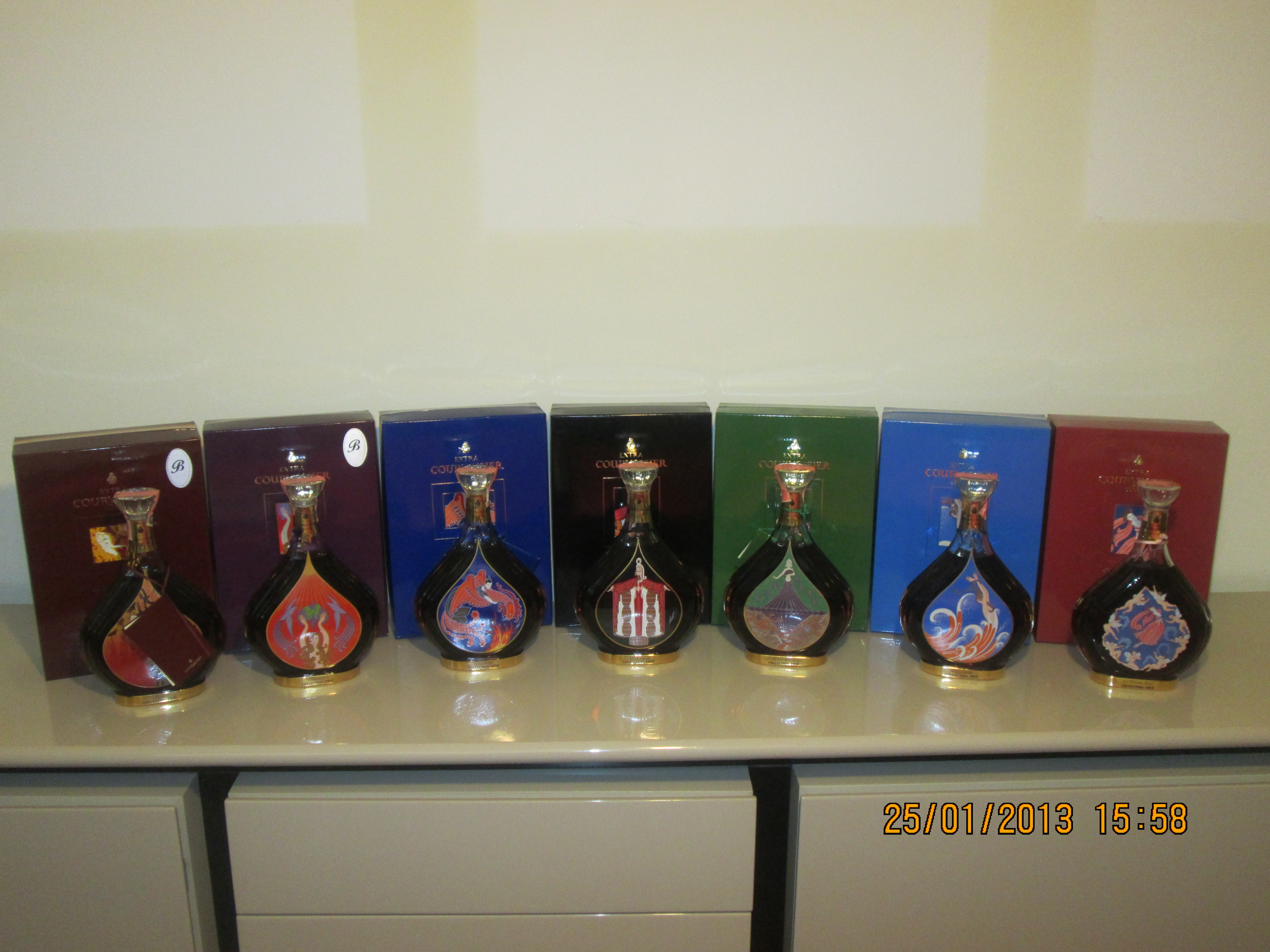 Complete Courvoisier Collection Erte 7 Bottles with cases and certifications