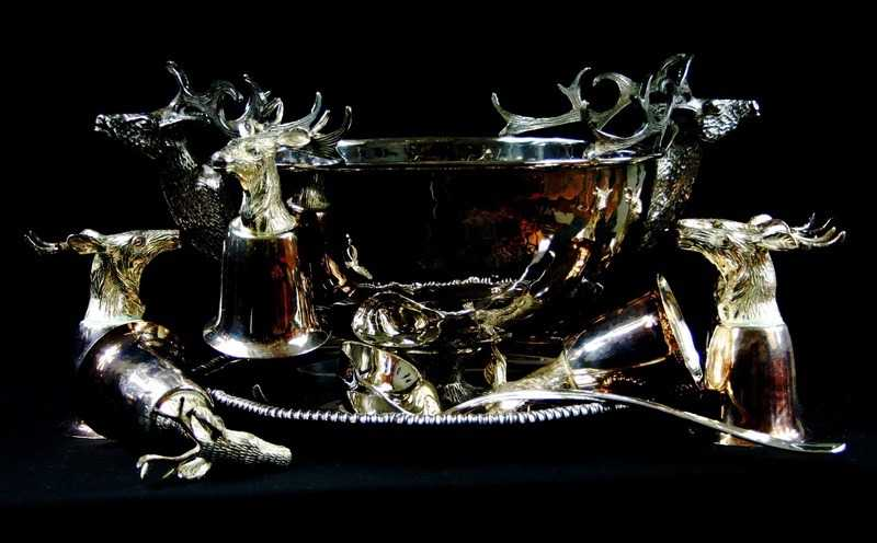 Punch bowl with stag head goblets