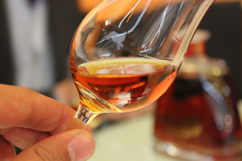 Swirling a glass of Cognac