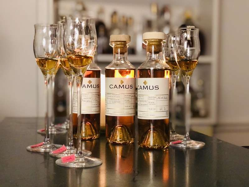Glasses and bottles of Camus Cognac