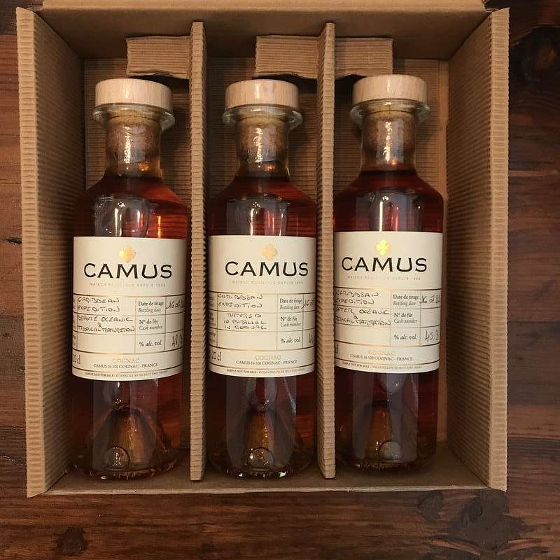 Three small bottles of Camus Cognac