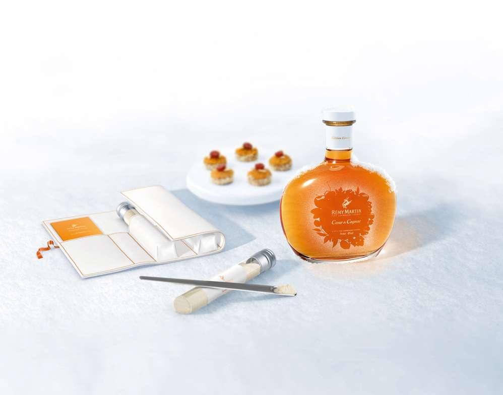 Cognac bottle, cakes, white wallet