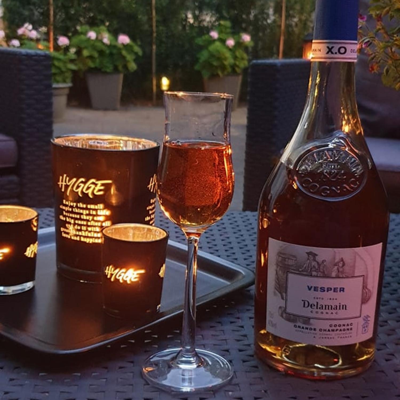 A bottle of Delamain Vesper enjoyed by candle light