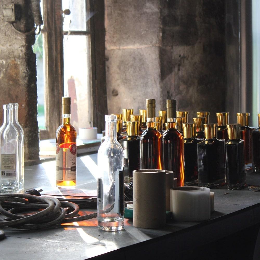 different unlabeled bottles of cognac